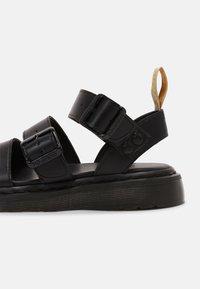 Dr. Martens - VEGAN GRYPHON UNISEX - Sandals - black - 6