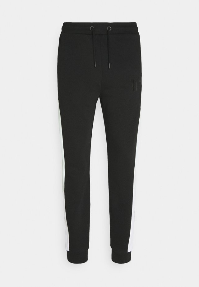 ASTRO JOGGERS REGULAR FIT - Pantaloni sportivi - black/glacier green/white