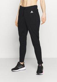 adidas Performance - Tracksuit bottoms - black/white - 0
