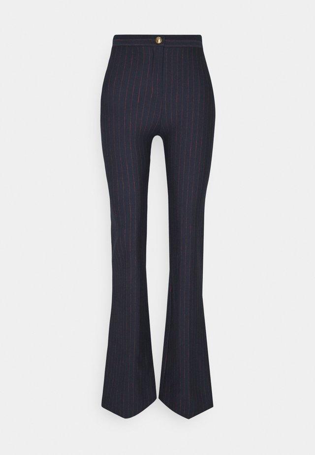 HULKI TROUSERS - Pantaloni - blue rosso
