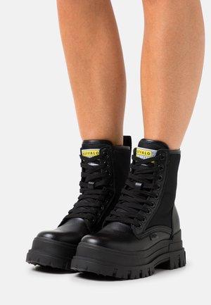 VEGAN ASPHA  - Platform ankle boots - black