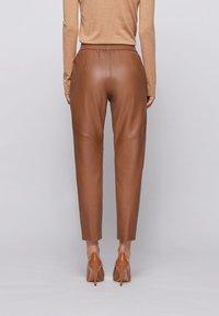 BOSS - SIWETTA - Trousers - light brown - 2