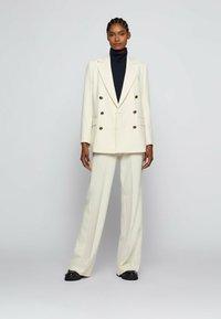 BOSS - TOCALITA - Trousers - natural - 1