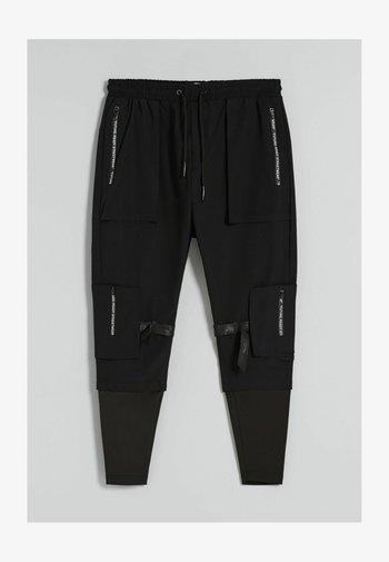 IM -STIL MIT  - Cargo trousers - black