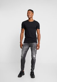 Tigha - BILLY THE KID - Slim fit jeans - mid grey - 1