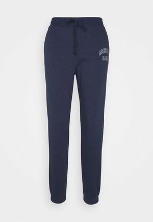 INTERNATIONAL BRANDED JOGGER - Tracksuit bottoms - navy