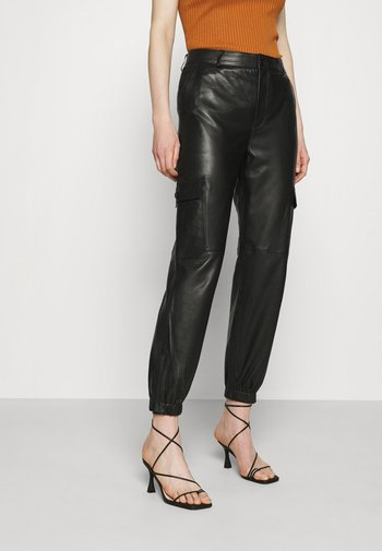 GERTA - Leather trousers - black