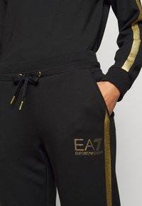 EA7 Emporio Armani - Tracksuit bottoms - black - 4