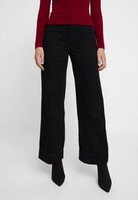 Neuw - MAGAZINE PANT - Trousers - black - 0
