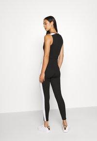 Puma - CLASSICS SHORTSLEEVE TIGHT - Jumpsuit - black - 2