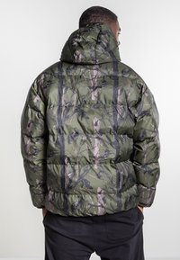 Carhartt WIP - JONES  - Winter jacket - Green