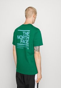 The North Face - MESSAGE TEE - Triko s potiskem - green - 2