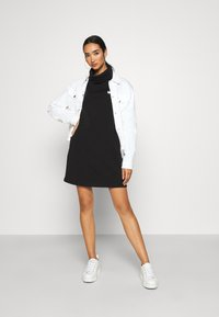 Tommy Jeans - BADGE MOCK NECK DRESS - Day dress - black - 1