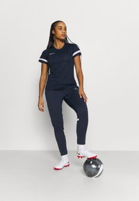 Nike Performance - PANT - Tracksuit bottoms - obsidian/white - 1