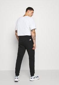 The North Face - PANT  - Teplákové kalhoty - black - 2