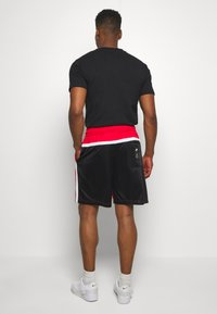 Nike Sportswear - Pantaloni sportivi - university red/black/white - 2