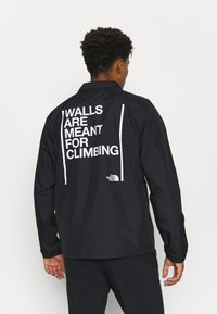 The North Face - WALLS ARE MEANT FOR CLIMBING COACHE - Kuoritakki - black - 2