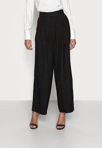 Anna Field Petite - Trousers - black - 0