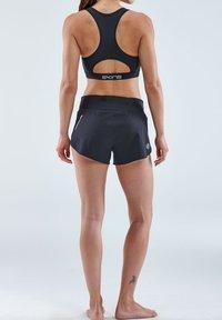 Skins - Sports shorts - black - 2