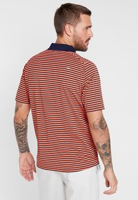 Kjus - MEN LUIS STRIPE - Polo - intensive peach - 2