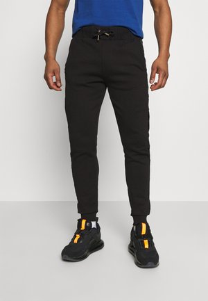 GALVEZ JOGGER - Tracksuit bottoms - black/gold
