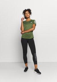 adidas Performance - OWN THE RUN TEE - Print T-shirt - khaki - 1