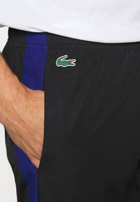 Lacoste Sport - TENNIS PANT - Tracksuit bottoms - black/cosmic white - 6