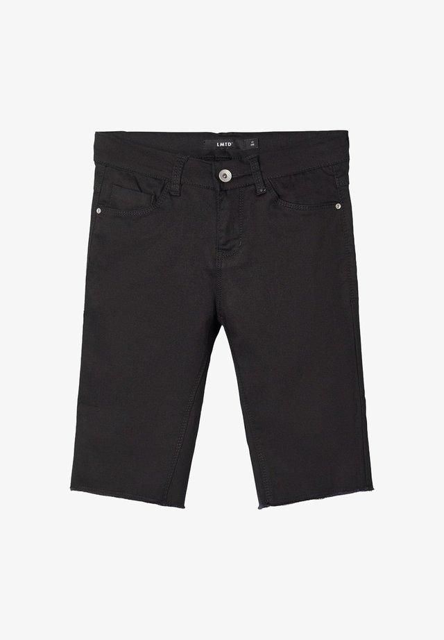 BIKER - Shorts vaqueros - black denim