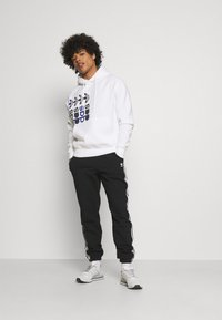 adidas Originals - HOODY UNISEX - Sweatshirt - white - 1