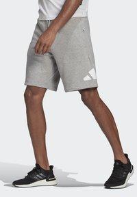 adidas Performance - M FI SHORT - Urheilushortsit - grey - 0