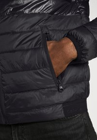 Calvin Klein - HOODED JACKET - Light jacket - black - 5