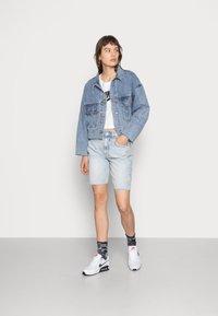 Nike Sportswear - TEE - T-shirts med print - white/black - 1