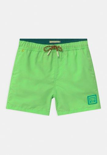 MAGIC PRINT - Swimming shorts - lemonade