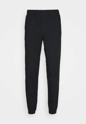 JJIVEGA JJDAVID PANTS - Trousers - black