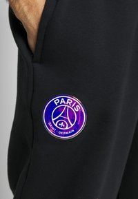Nike Performance - PARIS ST GERMAIN PANT - Tracksuit bottoms - black/psychic purple - 5
