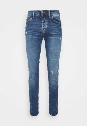ROCCO TRUEFLEX - Jeans slim fit - blue denim