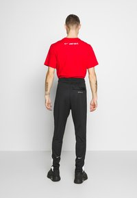 Nike Sportswear - Spodnie treningowe - black/white - 2