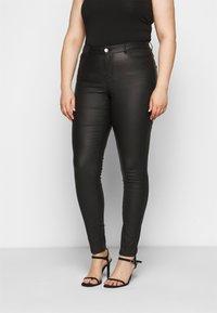 JUNAROSE - by VERO MODA - JRFOUR COATED PANTS - Jeans Skinny Fit - black - 0
