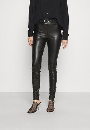 ONLHANNA ANKLE PANTS - Leggingsit - black