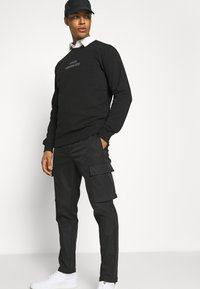 Samsøe Samsøe - SMITHY TROUSERS - Cargo trousers - black - 3