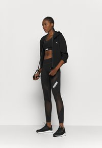Puma - PAMELA REIF X PUMA COLLECTION MID WAIST - Leggings - black - 1