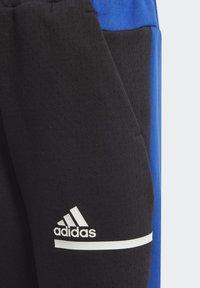 adidas Performance - Tracksuit bottoms - black - 8