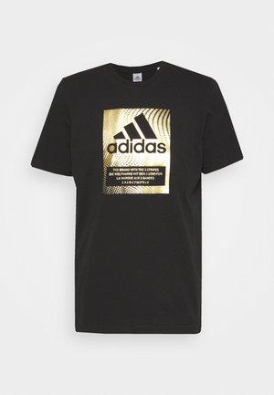 T-shirt con stampa - black/gold metallic