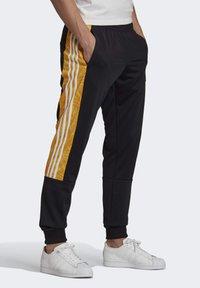 adidas Originals - BX-20 GRAPHIC TRACKSUIT BOTTOMS - Tracksuit bottoms - black - 3