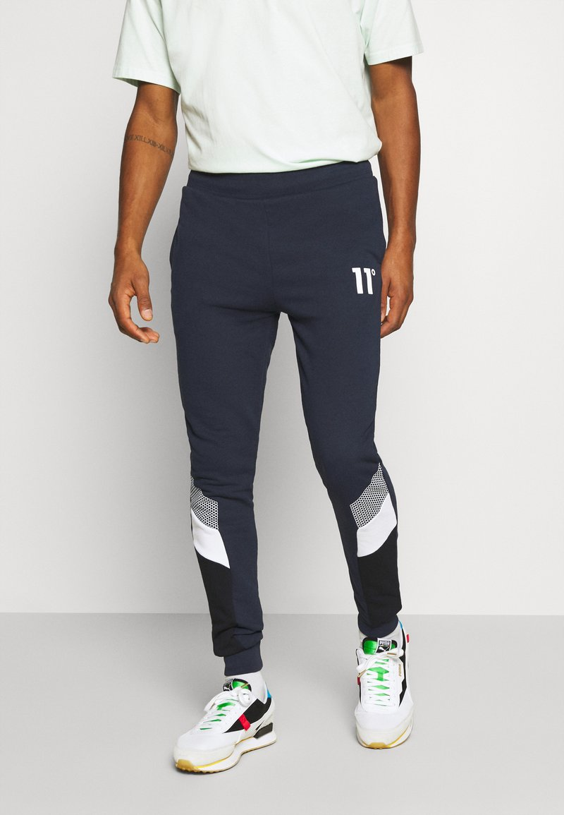11 DEGREES - MERCURY PRINT CUT AND SEW JOGGERS SKINNY FIT - Tracksuit bottoms - navy
