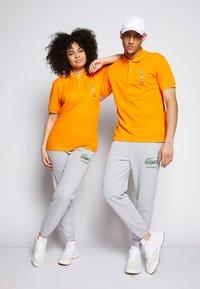 Lacoste - POLAROID UNISEX - Polo shirt - orpiment - 1