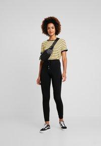 Topshop - MONO JEGGER - Leggings - Trousers - plain black - 1
