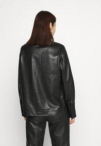 NA-KD - Button-down blouse - black - 2