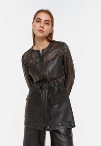 Uterqüe - 00665551 - Leather jacket - black - 0
