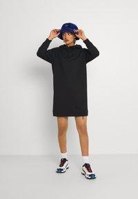 Vero Moda - VMOCTAVIALS HOODIE DRESS - Day dress - black - 1